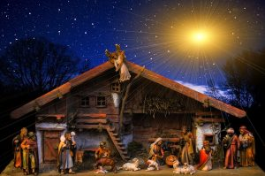 A nativity scene lit by a star