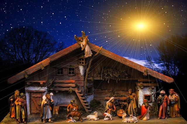 A nativity scene lit by a star
