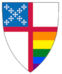 Multicolored icon in the shape of the Episcopal logo with a blue St Andrew's cross at the top left and the LGBTQ rainbow at the bottom right of the shield.