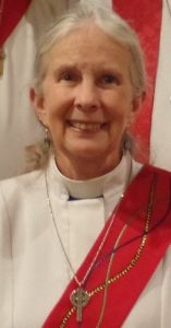 Image of smiling Deacon Lauri, to illustrate her potted biography.